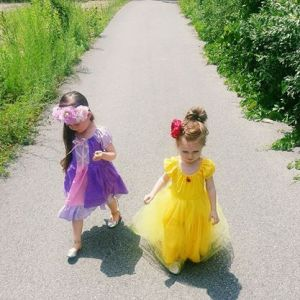 Princess Rapunzel and Belle dresses as well as the flower crown and rose clip all by R&T