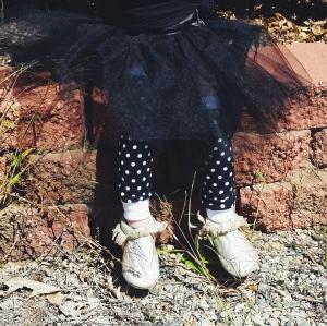 Black with white polka dot legwarmers.
